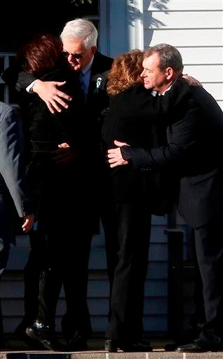 (AP Photo/Jason DeCrow). Mourners comfort one another before the funeral service of Victoria Soto at Lordship Community Church, Wednesday, Dec. 19, 2012, in Stratford, Conn.