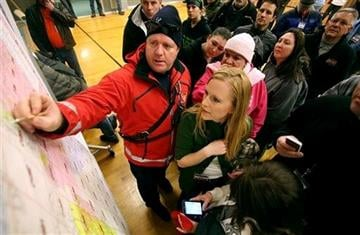 (AP Photo/Kristin Murphy, Deseret News). Unified firefighter Chris Thurman points out a meeting point to Christi Green and other volunteers before they leave to help search for 13-year-old Brooklyn Gittins a  in Herriman, Utah, on Thursday, Jan. 10, 2013.