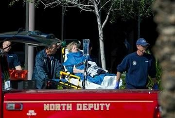 (AP Photo/The Arizona Republic, Michael Schennum). A woman is taken to a paramedic truck from an office building where a shooter opened fire in north central Phoenix on Wednesday, Jan. 30, 2013.