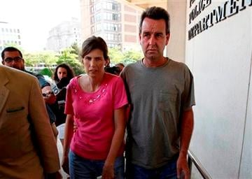 (AP Photo/Philadelphia Daily News, David Maialetti). Catherine, left, and Herbert Schaible arrive to turn themselves in at police headquarters in Philadelphia on Wednesday, May 22, 2013.