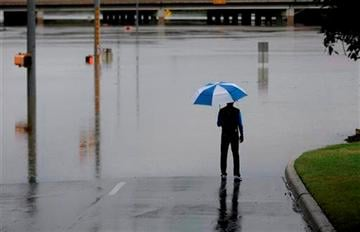 (AP Photo/Eric Gay). A man surveys floodwaters caused by heavy rains, Saturday, May 25, 2013, in San Antonio.