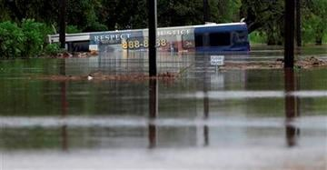 (AP Photo/Eric Gay). A San Antonio metro bus sits in floodwaters after it was swept off the road during heavy rains, Saturday, May 25, 2013, in San Antonio.