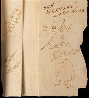 (AP Photo/Heritage Auctions). This undated photo provided by Heritage Auctions shows autographs by The Beatles on a 4-foot-by-2-foot section of a backdrop wall  from the New York theater where The Ed Sullivan Show theater took place.