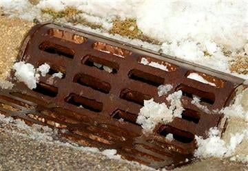(AP Photo/Northwest Herald, H. Rick Bamman). Snow melts on a storm drain after it was cleared by a public works crew in Crystal Lake, Ill.