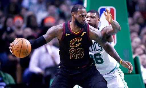 FILE - In this Jan. 3, 2018, file photo, Cleveland Cavaliers forward LeBron  James (23) works the ball inside during the second quarter of an NBA  basketball ...