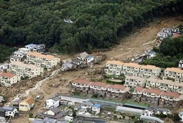 (AP Photo/Kyodo News). In this aerial photo, a rescue helicopter hovers over an area devastated by a massive landslide in Hiroshima, western Japan, Wednesday, Aug. 20, 2014.