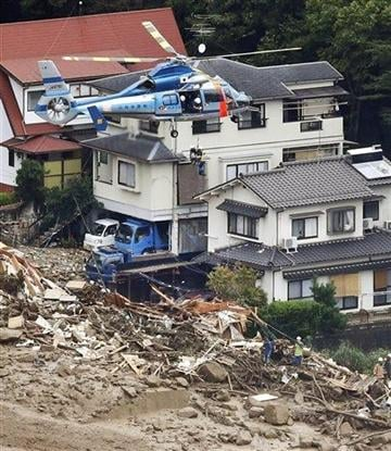 (AP Photo/Kyodo News). In this aerial photo, a survivor is lifted by a rescue helicopter from an area devastated by a massive landslide in Hiroshima, western Japan, Wednesday, Aug. 20, 2014.