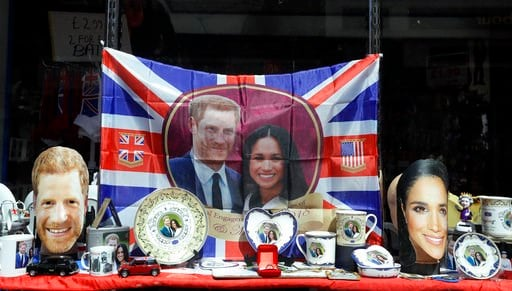 (AP Photo/Kirsty Wigglesworth). Merchandise is displayed for sale in a shop window in Windsor, England, Monday, May 14, 2018.