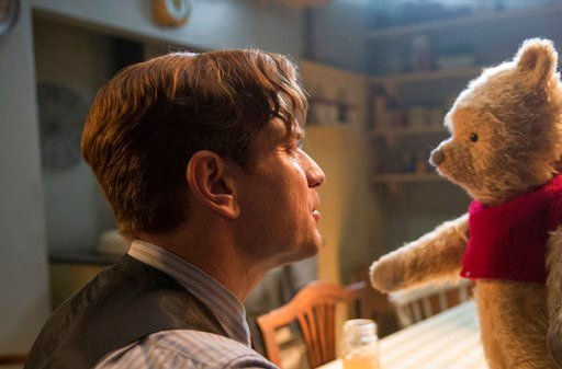"(Laurie Sparham/Disney via AP, File). FILE - This image released by Disney shows Ewan McGregor in a scene from ""Christopher Robin."" Tom Cruise has outrun Winnie-the-Pooh at the box office. ""Mission: Impossible -- Fallout"" topped ticket sales for the se..."