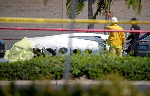 (Allen J. Schaben/Los Angeles Times via AP). Santa Ana fire and police and Orange County Fire departments respond to the scene of a deadly plane crash in a Santa Ana, CA, parking lot