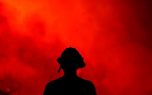 (AP Photo/Ringo H.W. Chiu). A firefighter keeps watch on the Holy Fire burning in the Cleveland National Forest in Lake Elsinore, Calif., Thursday, Aug. 9, 2018.