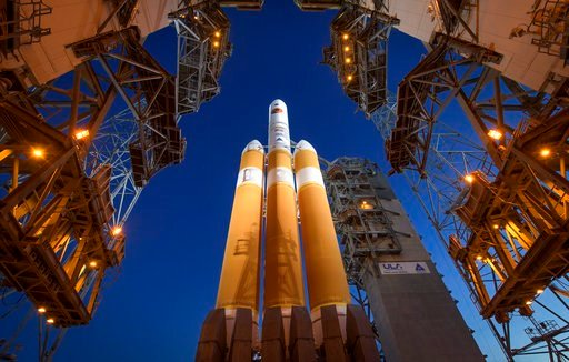 (Bill Ingalls/NASA via AP). The Mobile Service Tower is rolled back to reveal the United Launch Alliance Delta IV Heavy rocket with the Parker Solar Probe onboard, Saturday, Aug. 11, 2018, Launch Complex 37 at Cape Canaveral Air Force Station in Fla.