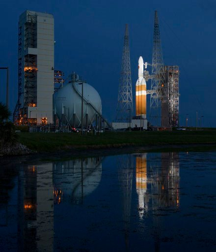 (Bill Ingalls/NASA via AP). This photo provided by NASA shows the United Launch Alliance Delta IV Heavy rocket with the Parker Solar Probe onboard shortly after the Mobile Service Tower was rolled back, Friday, Aug. 10, 2018.