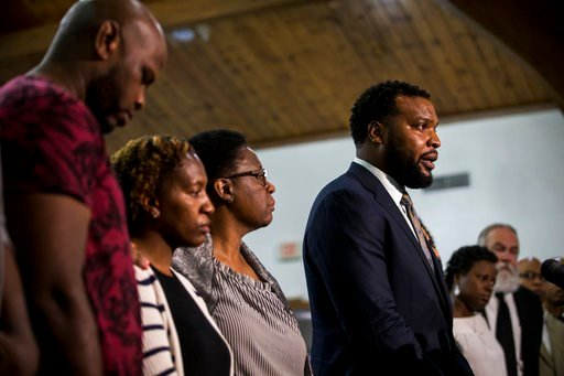 (Shaban Athuman/The Dallas Morning News via AP). Jean's family lawyer Lee Merritt gives talks to members of the press following a prayer vigil for Botham Shem Jean at the Dallas West Church of Christ on Saturday, Sept. 8, 2018 in Dallas.