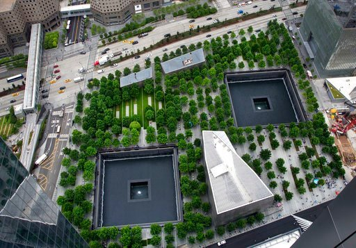 (AP Photo/Mark Lennihan, FIle). FILE - In this June 7, 2018 file photo, the World Trade Center site is seen from an upper floor of 3 World Trade Center in New York. The annual 9/11 commemorations are by now familiar rituals, centered on reading the nam...