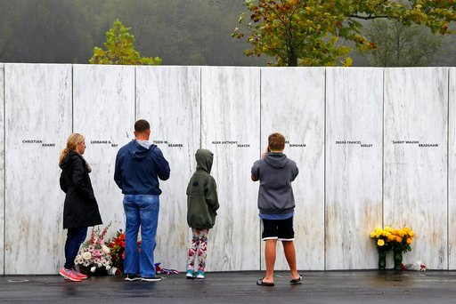 (AP Photo/Gene J. Puskar). Visitors to the Flight 93 National Memorial in Shanksville, Pa., participate in a sunset memorial service on Monday, Sept. 10, 2018, as the nation marks the 17th anniversary of the Sept. 11, 2001 attacks.