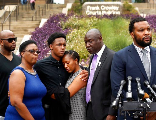 (Tom Fox/The Dallas Morning News via AP). Brandt Jean, center left, brother of shooting victim Botham Jean, hugs his sister Allisa Charles-Findley, during a news conference outside the Frank Crowley Courts Building on Monday, Sept. 10, 2018, in Dallas.