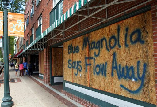 (Gray Whitley/Sun Journal via AP). Storefronts have wood paneling installed over windows, Tuesday, Sept. 11, 2018, in New Bern, N.C., as a  precaution against storm damage from Hurricane Florence.