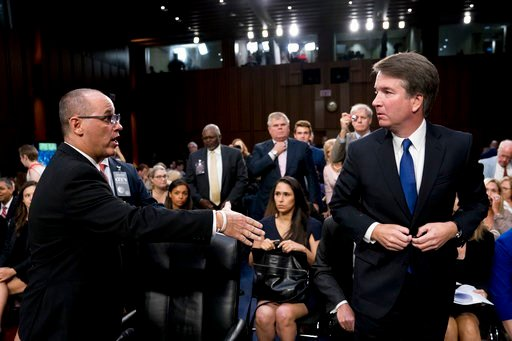 (AP Photo/Andrew Harnik, File). FILE - In this Tuesday, Sept. 4, 2018 file photo, Fred Guttenberg, the father of Jamie Guttenberg who was killed in the Stoneman Douglas High School shooting in Parkland, Fla., left, attempts to shake hands with Presiden...