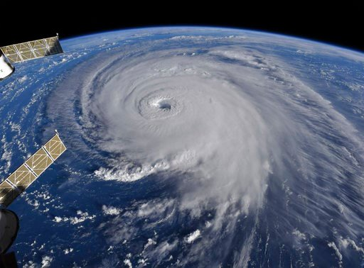 (NASA via AP). This image provided by NASA shows Hurricane Florence from the International Space Station on Wednesday, Sept. 12, 2018, as it threatens the U.S. East Coast.