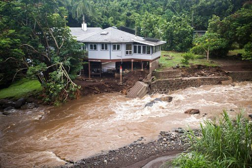 (Cindy Ellen Russell/Honolulu Star-Advertiser via AP). A home on Kahekili Highway near the Waihee River Bridge, was evacuated after a flash flood breached the property on Wednesday afternoon, Sept. 12, 2018, in Maui, Hawaii. Maui County says several ho...