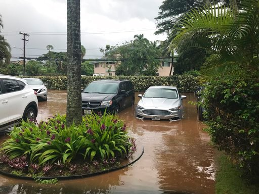 (Lauren Greer via AP). This Wednesday Sept. 12, 2018, photo shows floodwater in the parking lot of a condo complex at Kahana Village in Lahaina, Hawaii. Heavy rain and winds from a tropical storm downed trees, knocked out power and prompted evacuations...