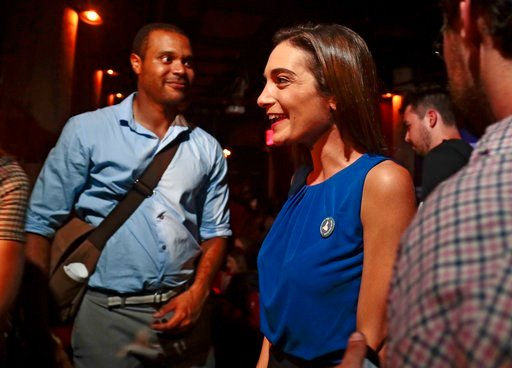 (AP Photo/Julie Jacobson). Julia Salazar, right, talks with supporters after winning the Democratic primary over Martin Dilan in New York's 18th State Senate district race, Thursday, Sept. 13, 2018, in New York.