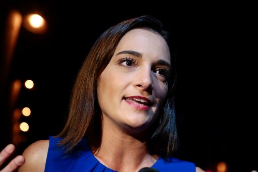 (AP Photo/Julie Jacobson). Julia Salazar answers questions during an interview after winning the Democratic primary over Martin Dilan in New York's 18th State Senate district race, Thursday, Sept. 13, 2018, in New York.