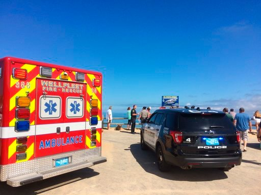 (Eric Williams/The Cape Cod Times via AP). Emergency personnel respond to Newcomb Hollow Beach in Wellfleet, Mass,  on Saturday, Sept. 15, 2018.   The Cape Cod Times says rescue crews responded to Newcomb Hollow Beach in Wellfleet at around noon Saturd...
