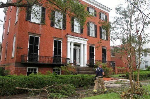 (Gray Whitley/Sun Journal via AP). New Bern firefighters check the safety of residents in a flood and wind damaged area of Johnson Street in historic New Bern, N.C., Sept. 15, 2018. Hurricane Florence brought high winds and storm surges to eastern Nort...
