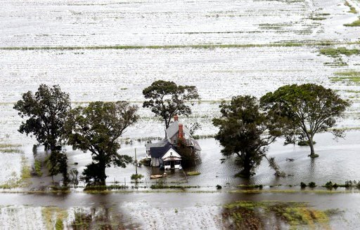 (AP Photo/Steve Helber). A farm house is surrounded by flooded fields from tropical storm Florence in Hyde County, N.C., Saturday, Sept. 15, 2018.