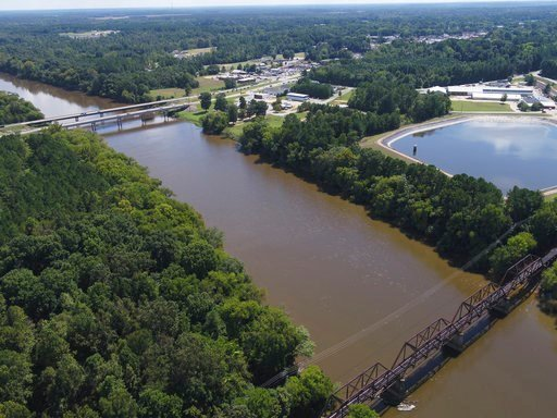 (DroneBase via AP, File). FILE - In this Tuesday afternoon, Sept. 12, 2018 file photo provided by DroneBase, an aerial view of the Cape Fear River, N.C., in Buckhorn, N.C. is shown ahead of Hurricane Florence. Record flooding is expected on North Carol...