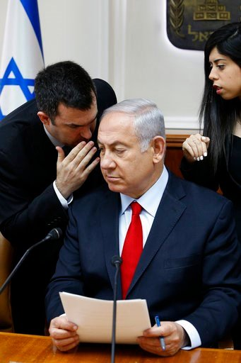 (Gali Tibbon/Pool via AP, File). FILE - In this July 23, 2018 file photo, Israeli Prime Minister Benjamin Netanyahu listens to his spokesman David Keyes as he opens the weekly cabinet meeting at his Jerusalem office. An opposition Israeli lawmaker is c...