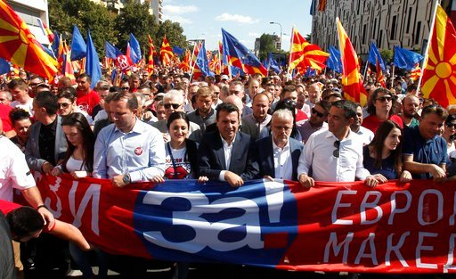 """(AP Photo/Boris Grdanoski). Macedonian Prime Minister Zoran Zaev, center, takes a part in a march named """"For European Macedonia"""", through a street in Skopje, Macedonia, Sunday, Sept. 16, 2018. Thousands of people marched in downtown of capital Skopje S..."""