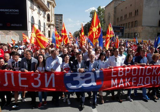 """(AP Photo/Boris Grdanoski). Macedonian Prime Minister Zoran Zaev, center, takes a part in a march holding a banner that reads """"Come out for European Macedonia"""", in downtown Skopje, Macedonia, Sunday, Sept. 16, 2018. Thousands of people marched in downt..."""