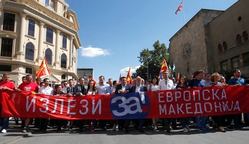 """(AP Photo/Boris Grdanoski). Macedonian Prime Minister Zoran Zaev, center, takes a part in a march holding a banner that reads """"Come out for European Macedonia"""", in downtown Skopje, Macedonia, Sunday, Sept. 16, 2018. Thousands of people have marched in ..."""