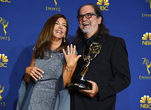 """(Photo by Jordan Strauss/Invision/AP). Glenn Weiss, right, winner of the award for outstanding directing for a variety special for """"The Oscars"""" and Jan Svendsen pose in the press room after getting engaged at the 70th Primetime Emmy Awards on Monday, S..."""