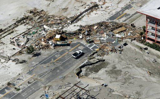 (AP Photo/Chris O'Meara). Debris from homes destroyed by Hurricane Michael block a road Thursday, Oct. 11, 2018, in Mexico Beach, Fla.