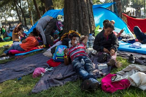 (AP Photo/Rodrigo Abd). Central American migrants relax after eating breakfast at the Jesus Martinez stadium in Mexico City, Wednesday, Nov. 7, 2018. Central American migrants on Wednesday continued to straggle in for a rest stop at a Mexico City stadi...