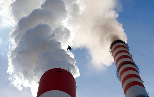 (AP Photo/Darko Vojinovic). In this photo taken Wednesday, Oct. 3, 2018, a bird flies past as smoke emits from the chimneys of Serbia's main coal-fired power station near Kostolac, Serbia. Chinese companies are currently involved in the construction of...