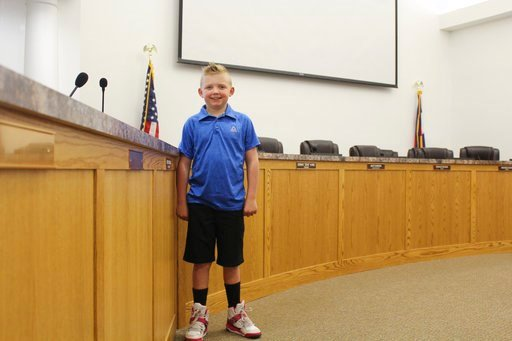 (Sara Knuth/Greeley Tribune via AP). In this Thursday, Nov. 29, 2018, photograph, 9-year-old Dane Best poses in the council chambers in Severance, Colo. Dane is trying to get rid of his town's ban on snowballs and officials are wondering what took so l...