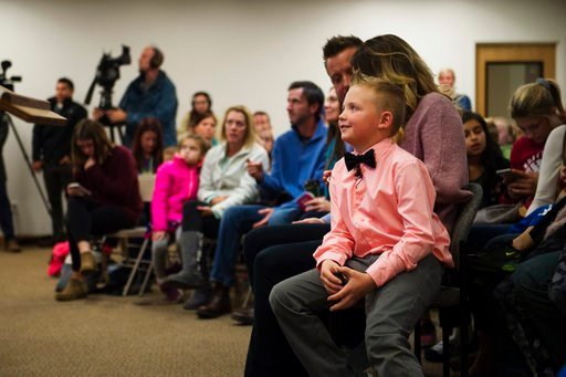 (Timothy Hurst/The Coloradoan via AP). Range View Elementary School third grader Dane Best sits on the lap of his mother, Brooke Best, during a town board meeting where he presented his argument to change a law in Severance that bans snowball fights on...