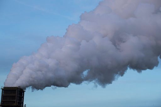 (AP Photo/Peter Dejong). Smoke billows from a chimney in IJmuiden, Netherlands, Tuesday, Dec. 4, 2018. The climate change conference, COP24, takes place in Katowice, Poland, from Dec. 2-14, 2018.