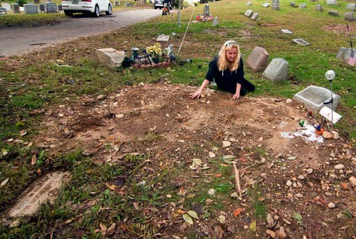 (Christian Abraham/Hearst Connecticut Media via AP, File). FILE - In this Oct. 3, 2018 file photo, a distraught Jean Stott, of Shelton, Conn., tries to find the exact spot where a family member is located after the tombstone, had been moved at Park Cem...
