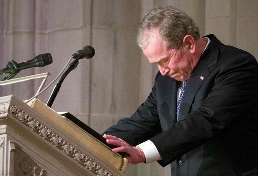 (AP Photo/Alex Brandon, Pool). Former President George W. Bush becomes emotional as he speaks at the State Funeral for his father, former President George H.W. Bush, at the National Cathedral, Wednesday, Dec. 5, 2018, in Washington.