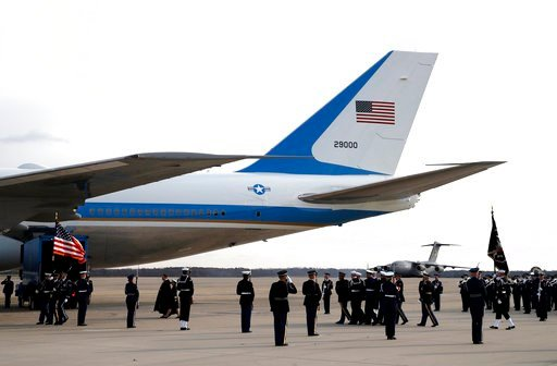 (AP Photo/Alex Brandon, Pool). The flag-draped casket of former President George H.W. Bush is carried by a joint services military honor guard to Special Air Mission 41, Wednesday, Dec. 5, 2018, at Andrews Air Force Base, Md.