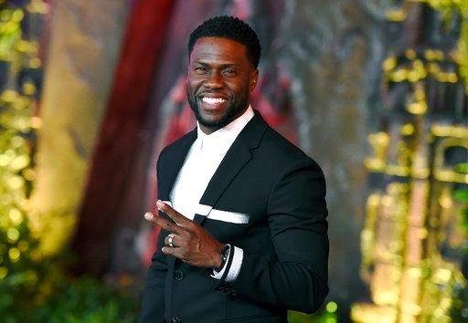 """(Photo by Jordan Strauss/Invision/AP, File). FILE - In this Dec. 11, 2017 file photo, Kevin Hart arrives at the Los Angeles premiere of """"Jumanji: Welcome to the Jungle"""" in Los Angeles. Hart will host the 2019 Academy Awards, fulfilling a lifelong dream..."""