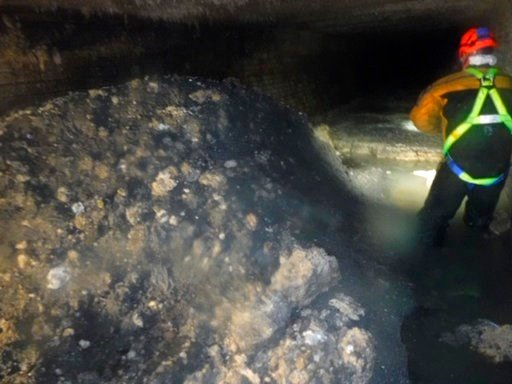 """(South West Water via AP). In this photo released Tuesday Jan. 8, 2019, by Britain's South West Water company, showing part of a """"fatberg"""", a mass of hardened fat, oil and baby wipes, measuring some 64 meters (210 feet) long, in the town of Sidmouth, E..."""