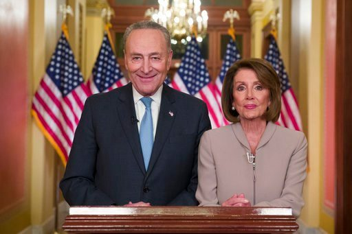 (AP Photo/Alex Brandon). Senate Minority Leader Chuck Schumer of N.Y., and House Speaker Nancy Pelosi of Calif., pose for photographers after speaking on Capitol Hill in response President Donald Trump's address, Tuesday, Jan. 8, 2019, in Washington.