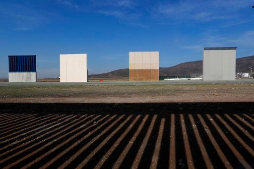 (AP Photo/Moises Castillo, File). FILE - In this Wednesday, Dec. 12, 2018, file photo, border wall prototypes stand in San Diego near the Mexico-U.S. border, seen from Tijuana, Mexico, where the current wall casts a shadow in the foreground.